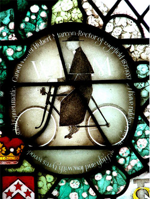 Stained glass roundal of the Canon Walter Herbert Marcon on his Bike in the church, Edgfield, Norfolk